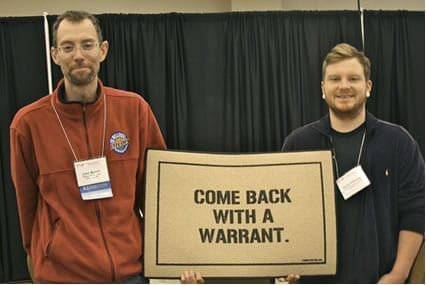 Members of the Whole Life Buying Club based in Louisville, Kentucky defied a quarantine order issued by the state health department in May; club co-administrator John Moody and Caine Halbrook received a doormat at an event in Dallas in honor of the club's successful act of group defiance. Photo Credit: Cheeseslave