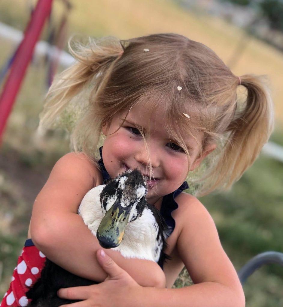 Girl Holding Duck
