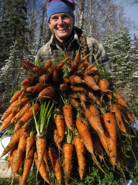 Allie of Chugach Farms with Carrots