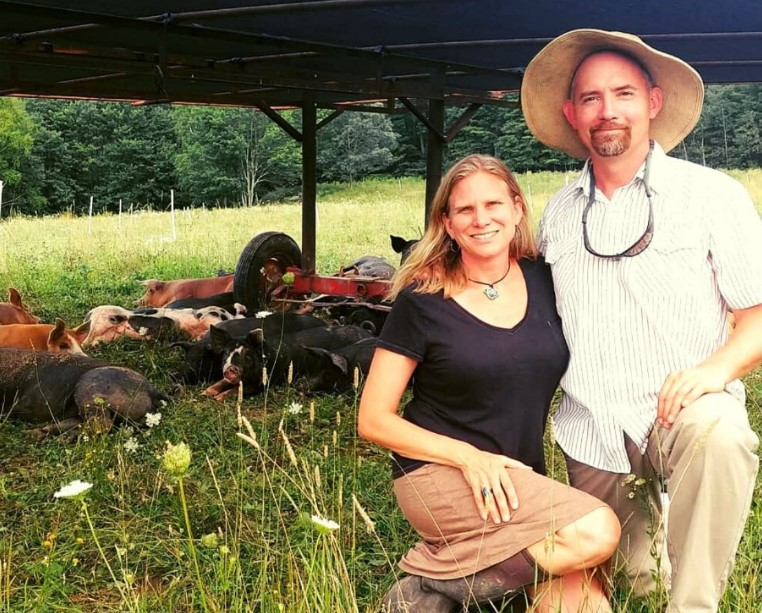 Holly and John Arbuckle with pastured pigs